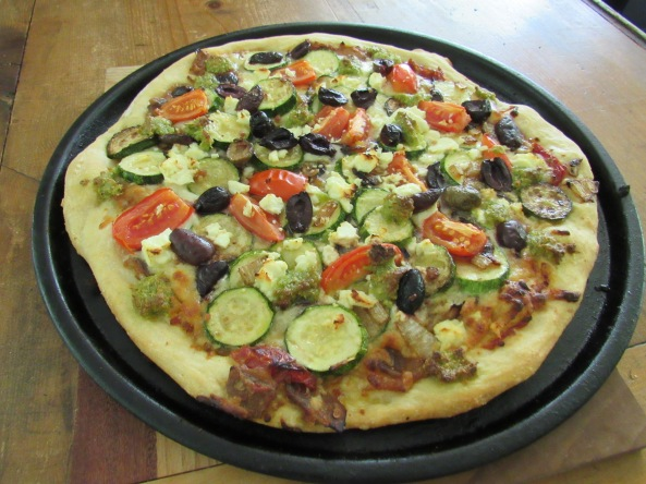 Lunch.....homemade pizza with zucchini, garlic scape pesto, fresh tomato, and olives